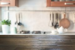 stock image of  blurred abstract background. modern kitchen with tabletop and space for display your products.
