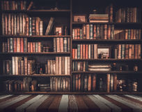 stock image of  blurred image many old books on bookshelf in library