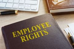 stock image of  book about employee rights.