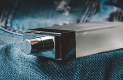 stock image of  bottle of perfume on jeans