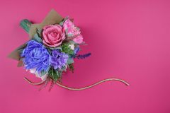 stock image of  a bouquet of colorful paper flowers on a magenta background as a backdrop for a postcard, invitation letter and etc