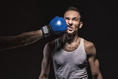 stock image of  boxing kick in the face