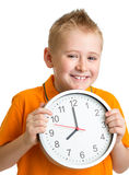 stock image of  boy displaying eight oclock time in studio isolated