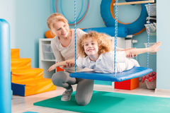stock image of  boy on therapy swing