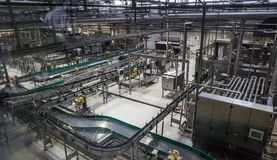 stock image of  brewery factory production line. conveyor, pipeline and other industrial machinery, no people