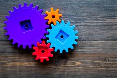 stock image of  bright gears for great technology of team work and correct mechanism on wooden background top view copyspace