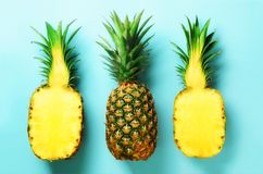 stock image of  bright pineapple pattern for minimal style. top view. pop art design, creative concept. copy space. fresh pineapples on