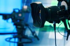 stock image of  broadcast television studio camera and crane camera in news studio room