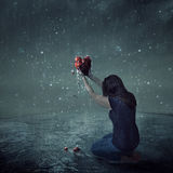 stock image of  broken heart during rain storm