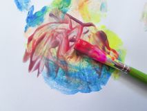 stock image of  brush with bright paints drawing on a white background hobbies