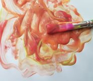 stock image of  brush with bright paints drawing on a  background hobbies