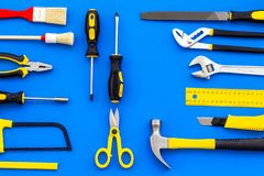 stock image of  building, painting and repair tools for house constructor work place set blue background top view pattern