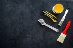 stock image of  building, painting and repair tools for house constructor work place set dark background top view space for text
