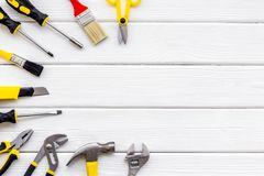 stock image of  building, painting and repair tools for house constructor work place set wooden white background top view space for text