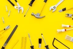 stock image of  building, painting and repair tools for house constructor work place set yellow background top view space for text