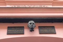 stock image of  on the building where lived tesla the plaque is established.