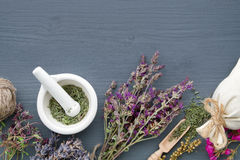 stock image of  bunches of healing herbs, mortar and sachet. herbal medicine.