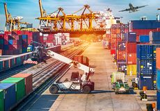 stock image of  business logistics concept ship, plane, truck and train for logistic import export with skyscraper backgrounground.