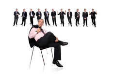 stock image of  business man and staff behind