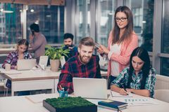 stock image of  business manager checking financial task of her colleagues. smart clever intelligent colleagues discussing the new start up projec