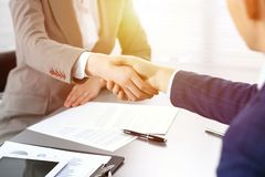 stock image of  business people shaking hands, finishing up a meeting. papers signing, agreement and lawyer consulting concept