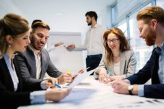 stock image of  business people working together on project and brainstorming