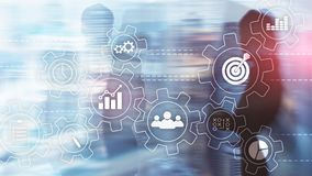 stock image of  business process automation concept. gears and icons on abstract background.