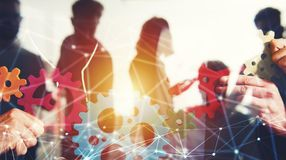 stock image of  business team connect pieces of gears. teamwork, partnership and integration concept with network effect. double