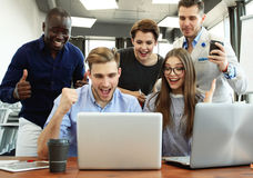 stock image of  business team success achievement arm raised concept.