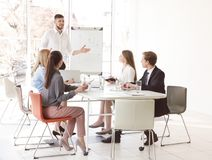 stock image of  business trainer giving presentation to group