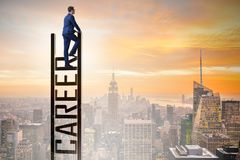 stock image of  the businessman in career ladder concept