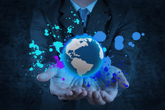stock image of  businessman holding a glowing earth globe