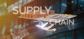 stock image of  businessman holding a supply chain title with a warehouse on background 3d rendering
