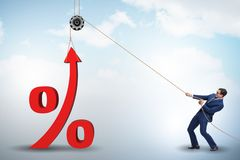 stock image of  the businessman increasing interest rate in market