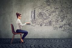 stock image of  businesswoman working in an office brainstorming business plan