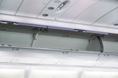 stock image of  the cabin luggage on airplane