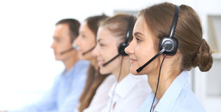 stock image of  call center operator in headset while consulting client. telemarketing or phone sales. customer service and business