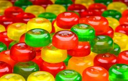 stock image of  candy background. close up. side view. colorful green, red and yellow sweetmeats candies background