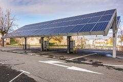 stock image of  car charging station for self-sufficient and first photovoltaic panels in europe. it is also free