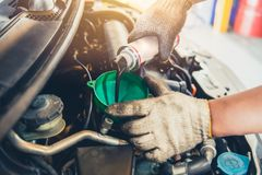 stock image of  car maintenance change oil and filling engine lube