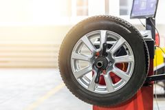 stock image of  car maintenance and service center. vehicle tire repair and replacement equipment. seasonal tire change