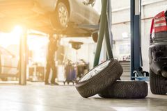 stock image of  car service center. vehicle raised on lift at maintenance station. auomobile repair and check up