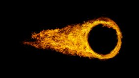 stock image of  car wheel or circle enveloped in flames isolated on black background.