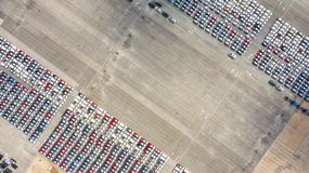 stock image of  cars export terminal in export and import business and logistics. shipping cargo to harbor. water transport international. aerial