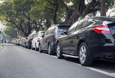 stock image of  cars parked row in city street, car park