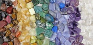 stock image of  chakra tumbled healing stones crsytal healing background