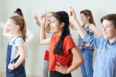 stock image of  group of children dancing in drama class together