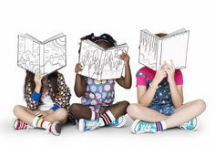 stock image of  children girlfriends reading book education togetherness studio