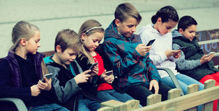 stock image of  children with mobile devices