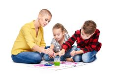 stock image of  children with therapist painting with watercolors. child art therapy, attention and concentration issues, learning difficulties.